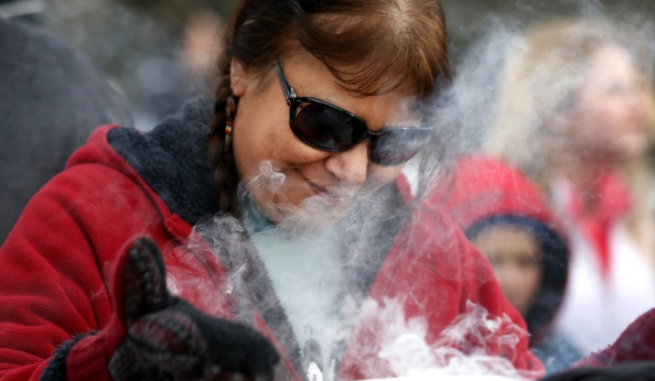 Beth Holcomb of Kasota received sage smoke during the Dakota Wokiksuye Memorial Ride Thursday.