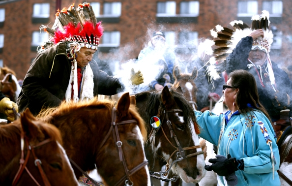 A rider received sage smoke from Corbie of Crow Creek, South Dakota, after arriving at Reconciliation Park for the Dakota Wokiksuye Memorial Ride Thursday in Mankato.